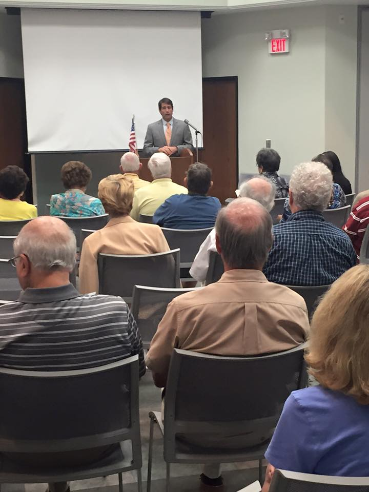 Congressman Garret Graves (R-LA) provides an overview of recent congressional activity for AMAC members in a Baton Rouge public library.
