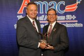 Dan Weber (L), President of AMAC, poses with Representative Joe Heck.